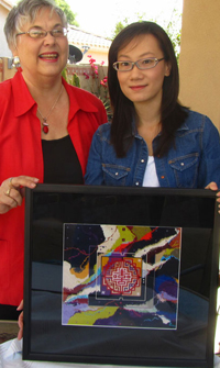 "Connie Pickering Stover and Bingxin Zhao, Dec. 2012 with ""Cosmic Joy""."